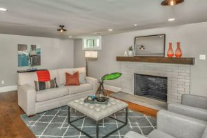 basement living room ideas with new paint and new flooring and updated fireplace bricks 1