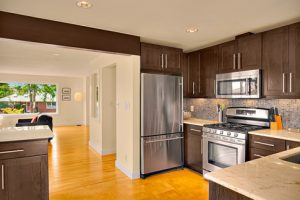 brand new countertops and walnut cabinets with new stainless steel appliances to match in this kitchen update