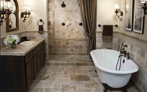earth tone tile flooring and standup custom shower with clawfoot white stand alone tub