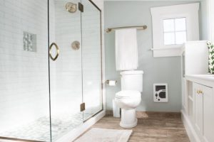 new tile flooring that looks like wood, enlarged bathroom with window surround and new white cabinets