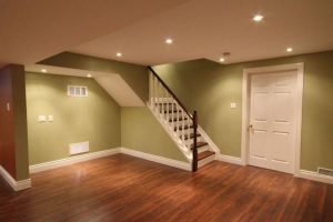 new wood floors in basement, new paint, new white doors, new trim work, and updated lighting