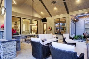 outdoor kitchen under porche to protect from weather with dining area and sitting area to entertain