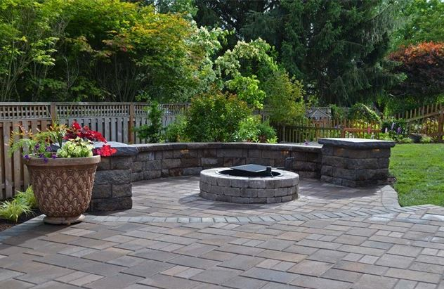patio paver with outdoor firepit, sitting area, and custom landscaping