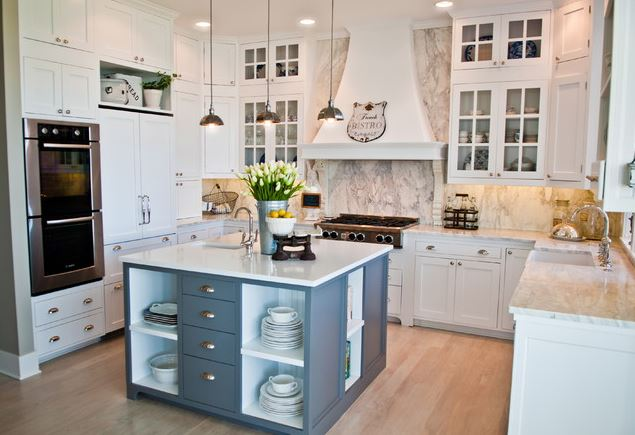 white cabinet kitchen remodel with large square island double oven and custom fridge